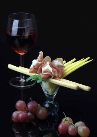 grissini: Gourmet dish with prosciutto and grissini Stock Photo
