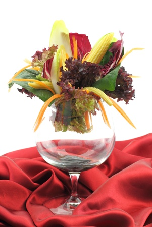 person appetizer: Stylish vegetables salad in glass