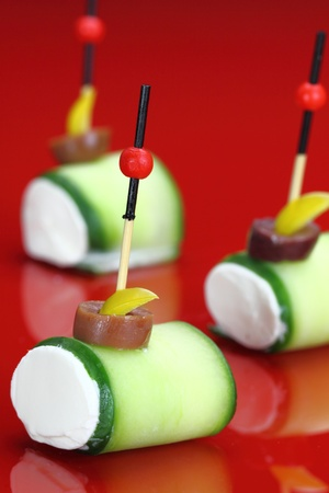 Finger food with Cucumber and cheese cream photo