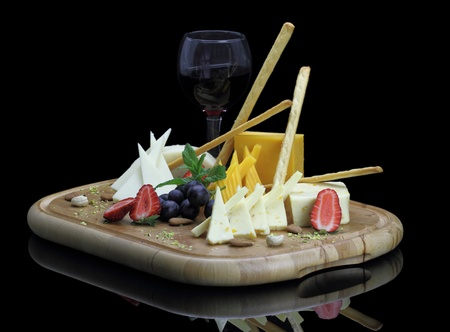 Cheese platter with fruits and nuts photo