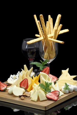 fruit platter: Various types of cheese on a cheese platter