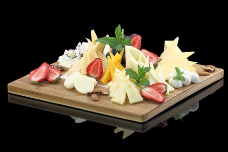 parmesan cheese: Various types of cheese on a cheese platter