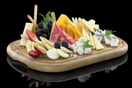 Various types of cheese on a cheese platter  photo