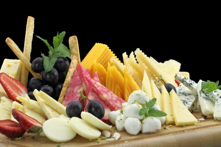 varieties: Various types of cheese on a cheese platter