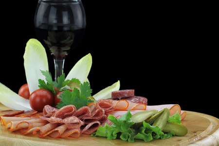 cold cuts: Meat delicatessen plate with vegetables Stock Photo