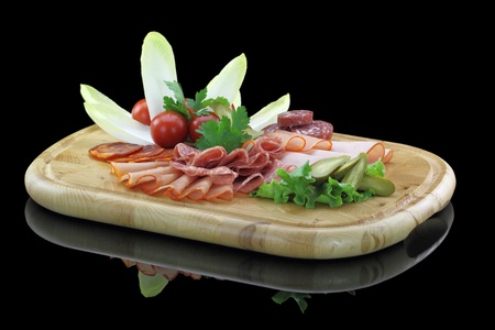 cherry varieties: Meat delicatessen plate with vegetables Stock Photo