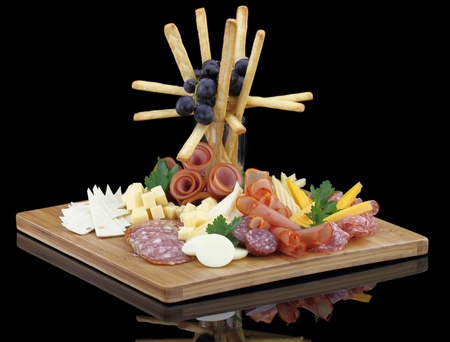 edam: Meat delicatessen plate with cheese and grissini Stock Photo