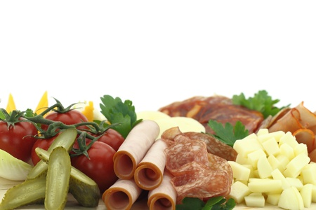 Meat delicatessen plate with cheese photo