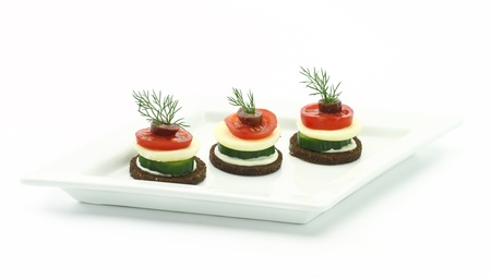 canapes: Canape with cheese and vegetables