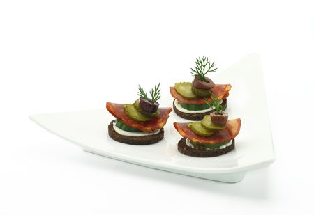 Canape with salami and vegetables photo