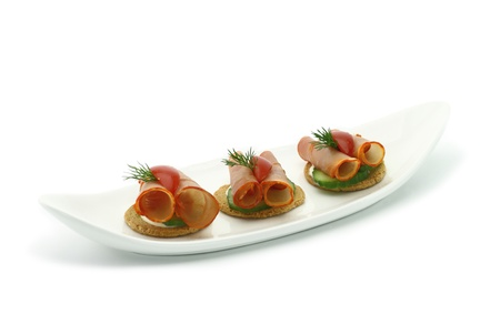 Canape with ham and vegetables photo