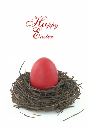Easter card with a red egg in the nest