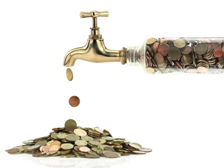 Money coins fall out of the golden tap Stock Photo
