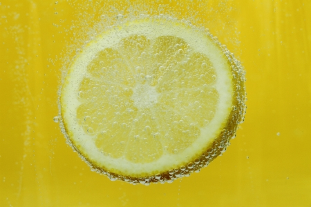 Lemon slice in water Stock Photo - 13733546