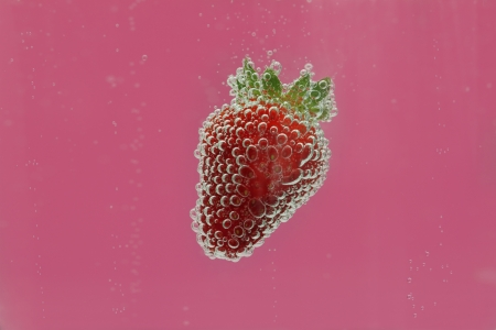 Strawberry in water photo