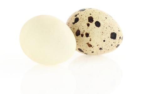 Quail eggs on white background. Damaged skin concept