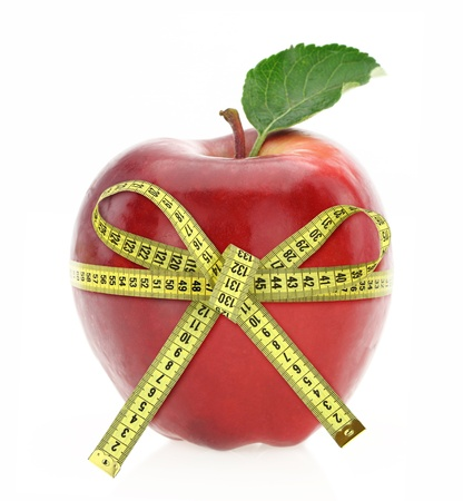 Diet concept. Apple with measuring tape photo