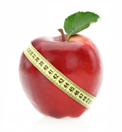 cellulite: Diet concept. Apple with measuring tape
