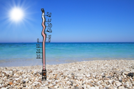 Melted thermometer on a beach shows high temperatures  Stock Photo - 14039962