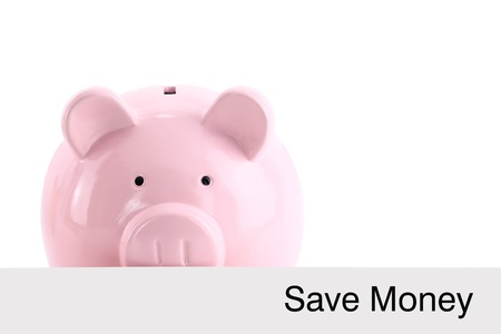 sales bank: Piggy bank hiding behind a banner isolated on white