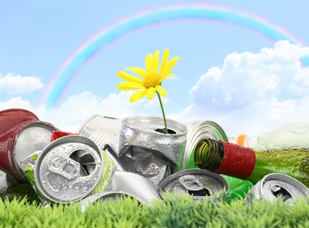Garbage with growing daisy under rainbow Stock Photo - 14039974