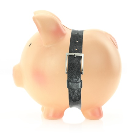 budget crisis: Piggy bank with a belt. Economic crisis concept