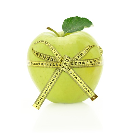 dietitian: Diet concept. Apple with measuring tape