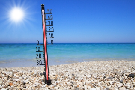 extreme heat: Thermometer on a beach shows high temperatures  Stock Photo