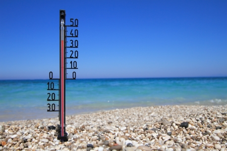 Thermometer on a beach shows high temperatures Stock Photo - 14039963