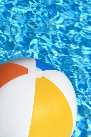 balls deep: Summer background. Beach Ball on the swimming Pool
