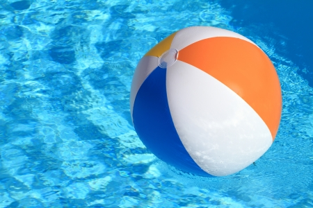 Swimming Pool Beach Ball Background summer background. beach ball on the swimming pool stock photo