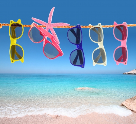various: Collection of sunglasses on the beach Stock Photo