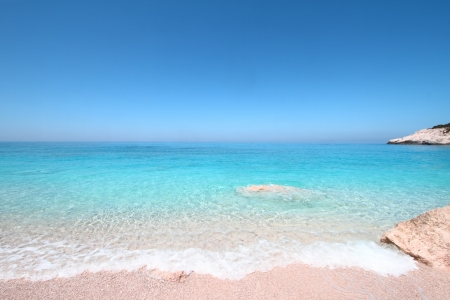 Turquoise sea and sky horizon photo