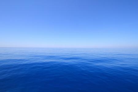 Blue sea and sky horizon photo