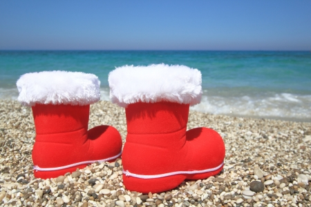 Santa Claus boots on the beach photo