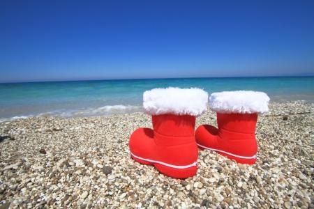 Santa Claus boots on the beach photo
