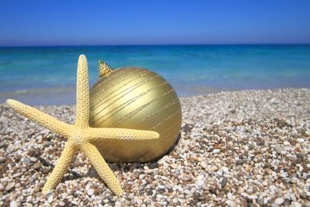 tropical christmas: Christmas ornaments on the beach