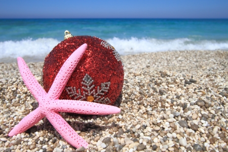 Christmas ornaments on the beach photo