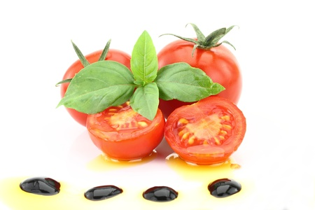 Tomato and basil garnished with olive oil and balsamic vinegar Stock Photo - 14472090