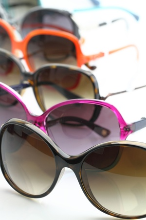 Collection of sunglasses on white background photo