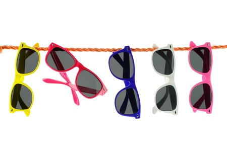 sun shades: Sunglasses hanging on a rope  Stock Photo