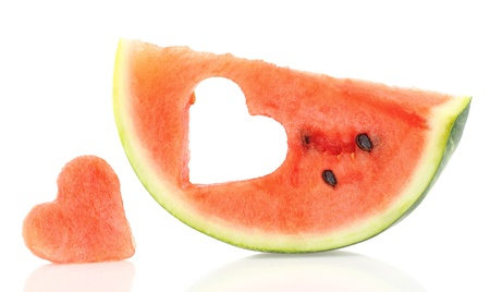 eat out: Watermelon slice with heart shape hole Stock Photo
