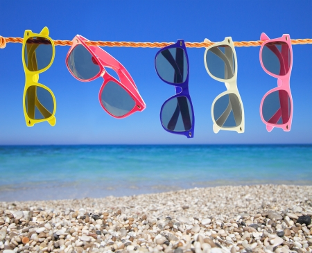 groups of objects: Collection of sunglasses on the beach Stock Photo