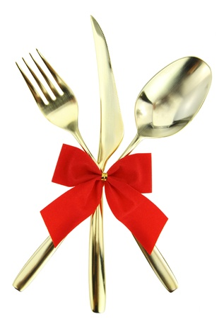 knife and fork: Christmas cutlery. Spoon, fork and knife stacked up on white background