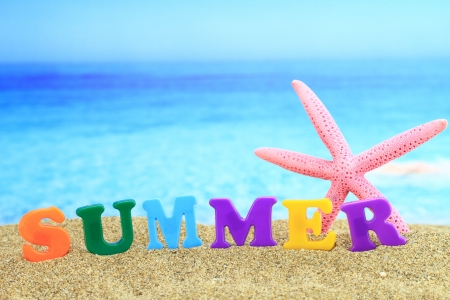 Summertime. The word �summer� on the beach photo