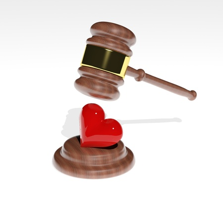 Gavel coming down on a 3d heart design  photo