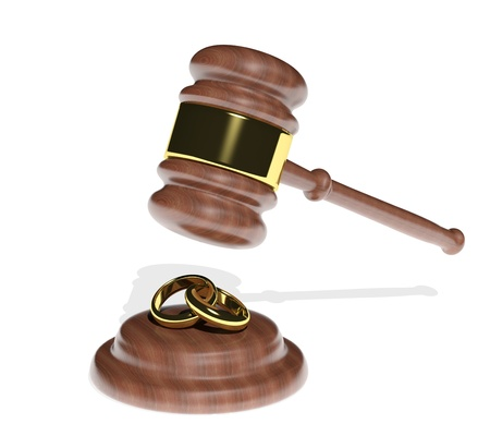 Gavel coming down on wedding rings  photo