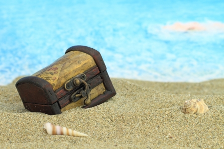 Closed treasure chest on a beach Stock fotó