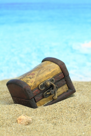 Closed treasure chest on a beach  photo