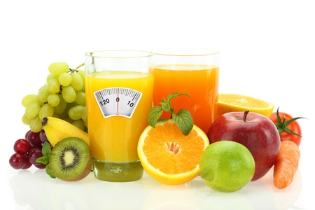 lose balance: Diet and healthy eating. Fruits, vegetables and juice on white Stock Photo
